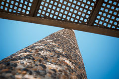 Low angle view on wooden shade of seating bench with pebble ston Stock Image