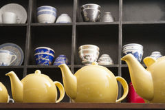Low angle view of yellow tea kettles Stock Image
