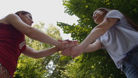 Low angle view of young attractive women cheering for victory stock video footage
