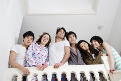 Low angle view of young friends smiling together Royalty Free Stock Images