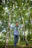 Low angle view of young man standing in park Stock Images