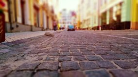 Low angle walking by the Old Town street. Creative abstract urban architecture retro background: Low angle walking by the Old Town street with stone pavement stock video