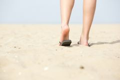 Low angle woman walking away at beach Royalty Free Stock Photo