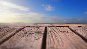 Wooden deck with a view of blue skies
