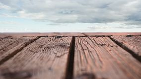 Wooden deck with a view of cloudy skies