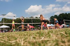 Free Low Angle Young Women Competing In Triples Grass Volleyball Tournament Stock Photography - 157344672