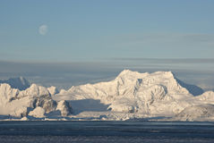 Low Antarctic mountain on which the moon is visible. Stock Photo