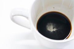 Low Black coffee in White Coffee Mug on white background Stock Photo