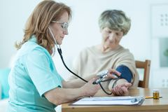 Low blood pressure. Old women has got a very low blood pressure stock images