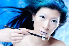 Low calorie eating. Studio face shot of Asian girl eating ice with chopsticks royalty free stock image