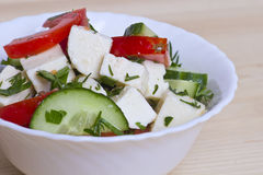 Low-calorie salad with fresh vegetables and cheese Royalty Free Stock Photography