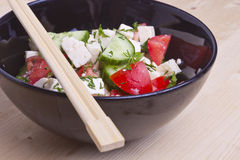 Low-calorie salad with fresh vegetables and cheese Stock Image