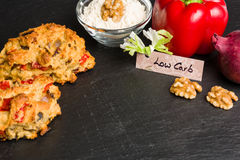 Low Carb bread roll with ingredients on black slate for diet Stock Photos