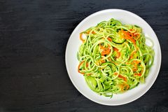Low carb zucchini noodle dish on dark slate Royalty Free Stock Photography