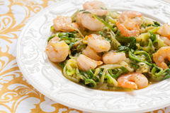 Low carb zucchini spaghetti with shrimp Stock Images