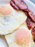 Bacon and eggs. Low Carbohydrate breakfast with bacon and fried eggs Royalty Free Stock Image