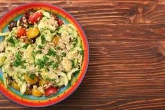 Low carbs Tuna Avocado Salad in glass bowl. Stock Photo