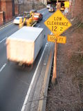 Low Clearance Sign. A low clearance traffic sign on a busy highway in New York, USA royalty free stock photography