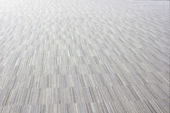 Low close up view of a beige furry carpet texture background, Stock Photography