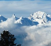 Low cloud winter alpine mountain scene under a blue sky Royalty Free Stock Photos