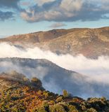 Low clouds and autumn colors in the catalan highlands royalty free stock photography