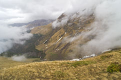 Low clouds in the mountains. Stock Photos
