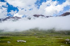 Low clouds in mountains Stock Photo