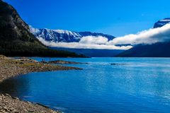 Low clouds over Lake Minnewnaka. Banff National Park, Alberta, Canada, featuring shoreline and lake Stock Image