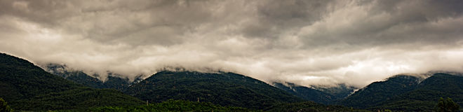 Low clouds over the mountains Stock Photos