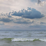 Low clouds over sea with waves Stock Photos