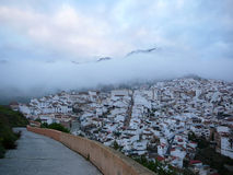 Low Clouds over white village Royalty Free Stock Photo