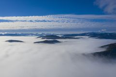 Low clouds in valley, aerial morning scene royalty free stock images