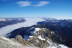 Low clouds in the valley below Pramaggiore Peak Stock Images