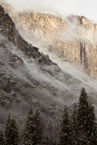 Low Clouds in Yosemite. Dreamy winter landscape of clouds climbing up El Capitan in Yosemite National Park, California Stock Images