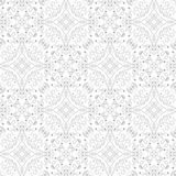 Low contrasting vintage ornament, gray drawing on white background. Repeating filigree geometric patterns in victorian style. Royalty Free Stock Images