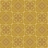 Low contrasting vintage ornament, light yellow drawing on golden background. Repeating filigree geometric patterns in victorian st. Yle Royalty Free Stock Photography