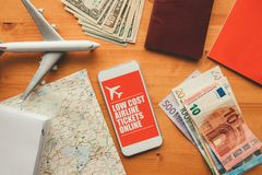 Low cost airline tickets online mobile app. Man holding smartphone with mock up application screen related to holiday vacation journey trip royalty free stock image