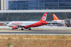 Low cost airlines. Air Berlin and Easyjet at Malaga airport (Spain stock photography