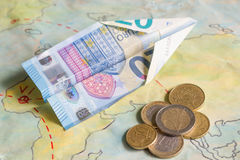 Low cost airlines with plane and euro money concept. Closeup stock image