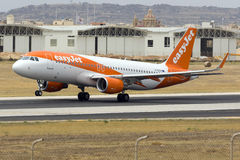 Low-cost EasyJet Airbus on take off. Luqa, Malta 28 May 2016: EasyJet Airline Airbus A320-214 [G-EZOV] departing runway 13 royalty free stock image