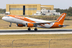Low-cost EasyJet Airbus on take off. Luqa, Malta 28 May 2016: EasyJet Airline Airbus A320-214 [G-EZOV] departing runway 13 royalty free stock photos