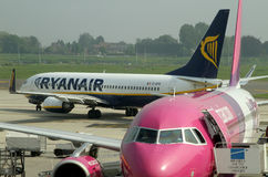 Low Cost fly companies. Planes parked on Charleroi airport - Ryanair and Wizz air airplanes stock photography