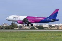 Low-cost Hugarian carrier Wizz Air Airbus. Luqa, Malta - December 3, 2018: Wizz Air Airbus A320-232 REG: HA-LWF landing runway 31 royalty free stock image