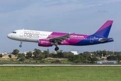 Low-cost Hugarian carrier Wizz Air Airbus. Luqa, Malta - December 3, 2018: Wizz Air Airbus A320-232 REG: HA-LWF landing runway 31 stock photos