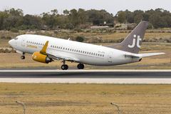 Low-cost Jettime 737 on take off. Luqa, Malta 28 May 2016: Jet Time Boeing 737-33A [OY-JTA] departing runway 13 to Billund royalty free stock photography