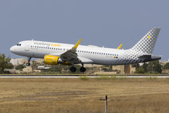 Low-Cost Spanish carrier Vueling A320. Luqa, Malta July 19, 2017: Vueling Airlines Airbus A320-214 [REG: EC-LVO] landing runway 31, arriving from Barcelona stock image