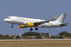 Low-Cost Spanish carrier Vueling A320. Luqa, Malta July 19, 2017: Vueling Airlines Airbus A320-214 [REG: EC-LVO] landing runway 31, arriving from Barcelona royalty free stock photography