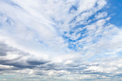 Low cumuli clouds in blue sky. In summer day Royalty Free Stock Images