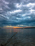 Low and dark clouds over Danube river before a storm in Belgrade Stock Photos