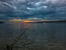 Low and dark clouds over Danube river before a storm in Belgrade Royalty Free Stock Image